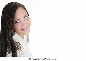 Cute Latina teenage girl smiling with braces on a white...