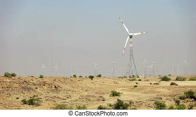 Wind power plants at desert. - 1920x1080 video - Modern wind...