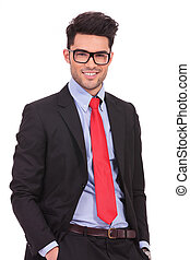 business man with hands in pockets - attractive young...