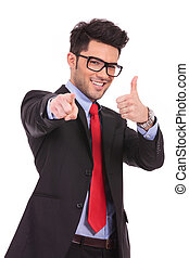 man shows that you are ok - young business man pointing...