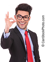 business man showing ok sign - portrait of a young business...