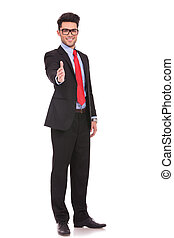 business man offers handshake - full length picture of a...