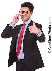 business man thumbs up at the phone - cutout picture of a...