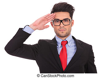 business man saluting - portrait of ayoung business man...