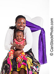 Smile a bigger smile. - A young mother playing with her new...