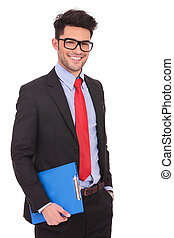 man with clipboard & hand in pocket - young business man...