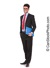 business man holding clipboard - full length picture of a...