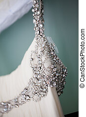 Straps with beading - The top cut of the wedding dress of...