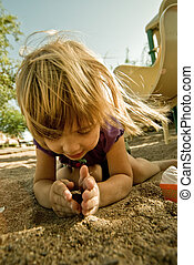 Child - A four year old girl, playing outside.