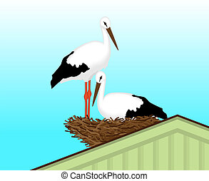 Two white storks made u200Bu200Ba nest on the roof of the...