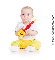 Funny baby  girl playing with musical toy. Isolated on white background