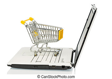 shopping cart - an empty cart on a laptop computer. symbolic...