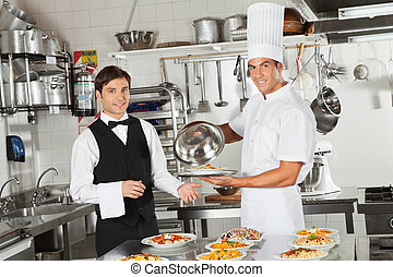 Waiter Taking Customer's Food From Chef - Portrait of happy...