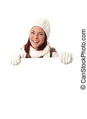Woman in winter with a big bord with copy space