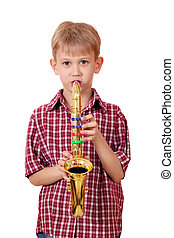 boy play music on saxophone portrait