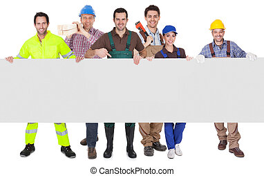Group of workers presenting empty banner Isolated on white