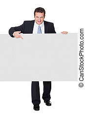 Successful businessman presenting empty banner Isolated on...