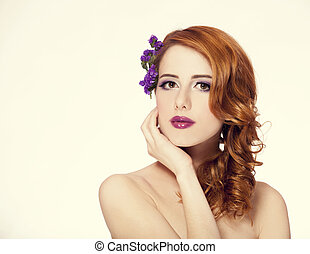 Redhead girl with flower, isolated