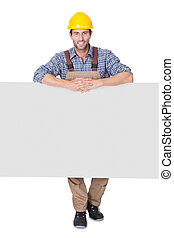 Construction worker presenting empty banner - Portrait of...