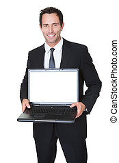 Happy middle aged businessman with laptop