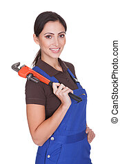 Female Plumber With A Wrench