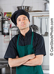 Serious Male Chef With Arms Folded - Portrait of serious...