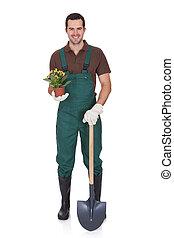 Feliz, jovem, jardineiro, segurando, flores