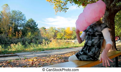 Child eating cotton candy - Little girl eating pink cotton...