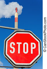 industrial chimney and stop sign - chimney of an industrial...