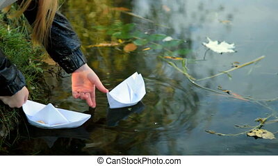 Child playing paper boat - Little girl playing paper boat