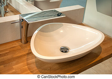 Bathroom interior with modern sink and faucet - Bathroom...