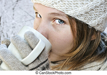 Winter girl - Teenage girl in winter hat with cup of hot...