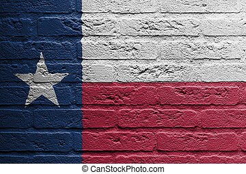 Brick wall with a painting of a flag, Texas - Brick wall...