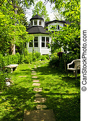 Home and garden - Path of steeping stones leading to a house...