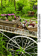 Flower cart in garden - Flower cart with two baskets in...