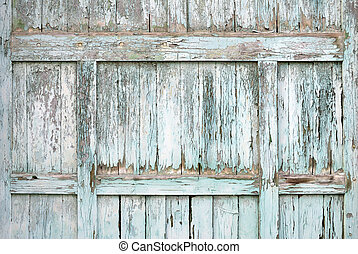 Paint-peeling wooden old door texture detail