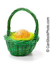 painted easter eggs in basket, isolated on white background.