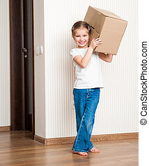 moving into a new home carrying cardboard boxes