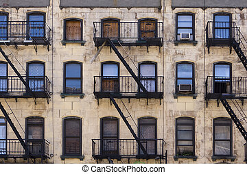 New York Tenement Building - Three floors of windows with...