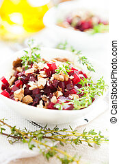 boiled beets with walnuts, salad in a small salad bowl