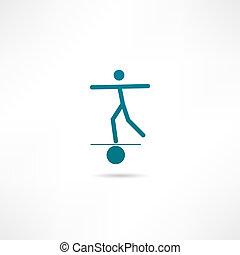 A man balances on a ball