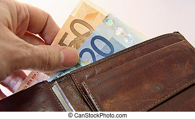 hand that pays taking the euro money from wallet