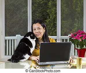 Mature woman Teleworking at home - Mature Asian woman and...