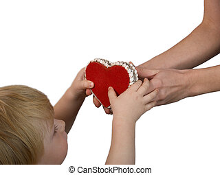 The child reaches for a heart figure