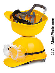 two yellow hard hats on white background