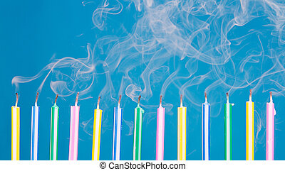 birthday candles in a row with smoke - Birthday candles in a...