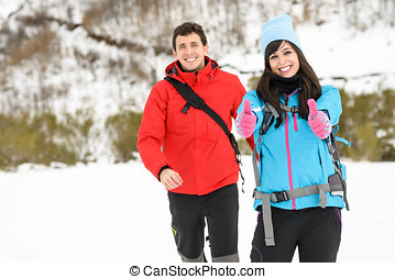 Couple winter mountain hiking