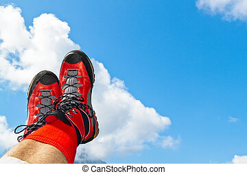 walking shoes with hiking in the mountains - red hiking...