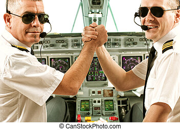 Airline pilots - Two airline pilot wearing uniform with...