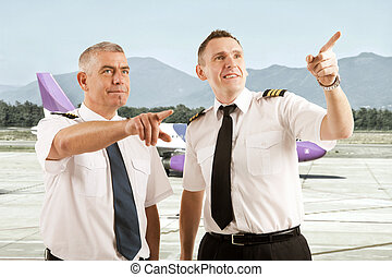 Airline pilots - Cheerful two airline pilots wearing uniform...